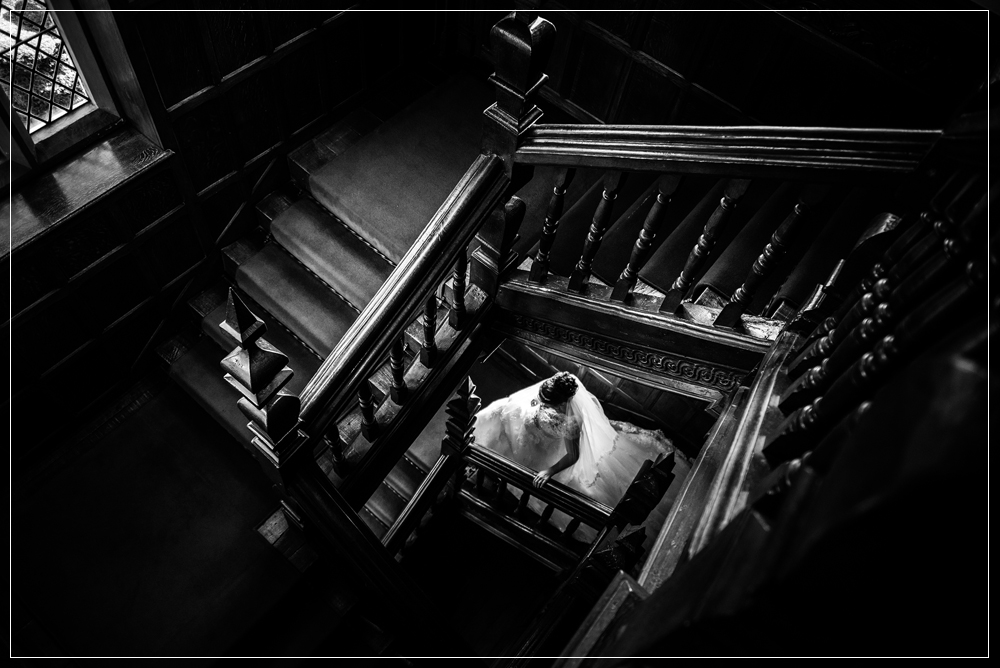 Bride on stairs at Great Fosters Egham